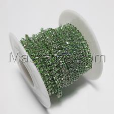 Стразовая цепь SS6 (1,9-2,0 мм).Цвет №25 салатовый.Оправа серебро,1 м